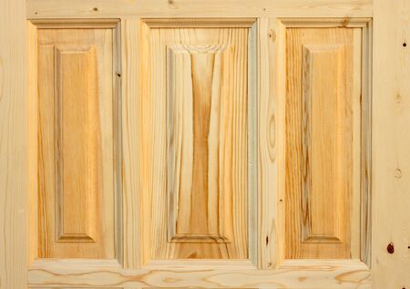 Fragment wooden door made of coniferous tree on white background Stock Photo - 7242370