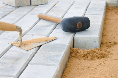 block of flats: Stone blocks laying down on sand Stock Photo
