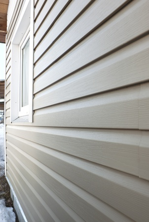 house siding: Wall of the house, finished in vinyl siding and window