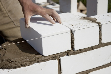 Construction of the wall of white brick