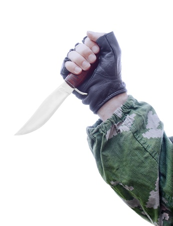 A knife in a mans hand on a white background photo