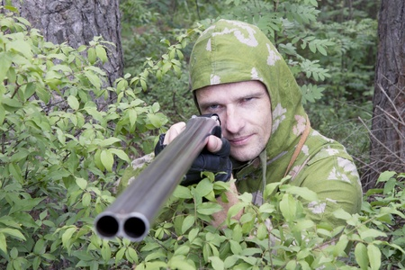 The shooter in camouflage with an old gun