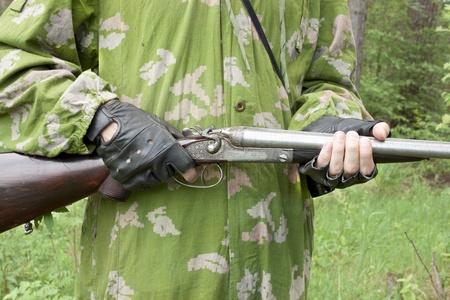 Antique gun in the hands of the hunter Stok Fotoğraf