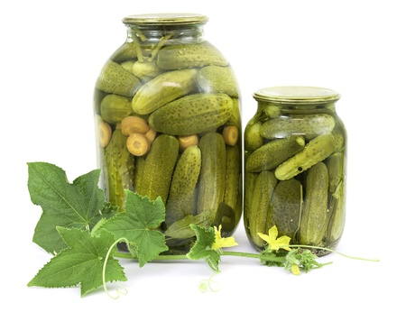 canned: Pickled cucumbers in jars on a white background Stock Photo