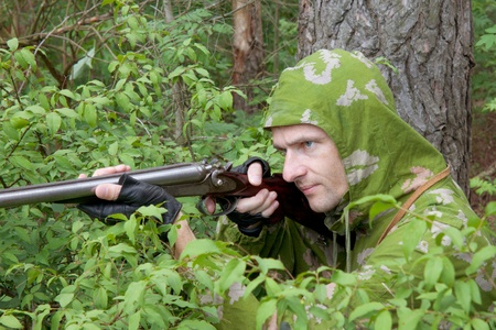 The shooter in camouflage with an old trigger gun