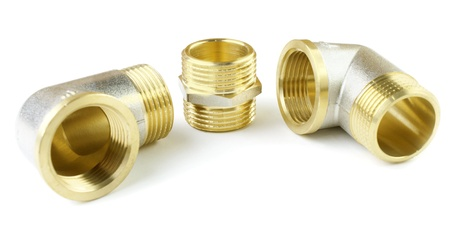 Three brass threaded details on a white background Stock Photo