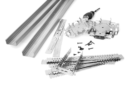 Many components for installation of gypsum panels on the white background Stock Photo