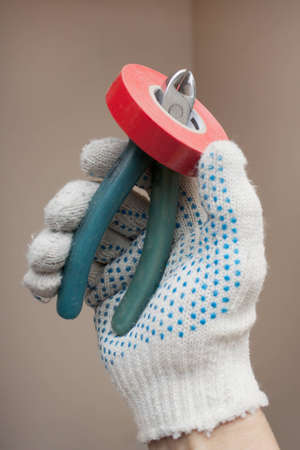 handbreadth: Hand holding the working cutters and electrical tape