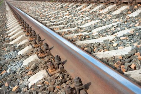 Crushed stone and rusted bolts on the railway photo