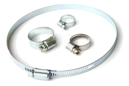 Metal clamps for construction purposes on a white Stock Photo
