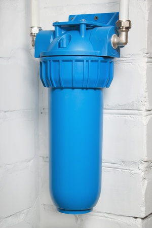 Blue plastic filter housing for water purification photo