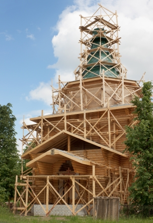 Construction of a wooden church in the village  Russia photo
