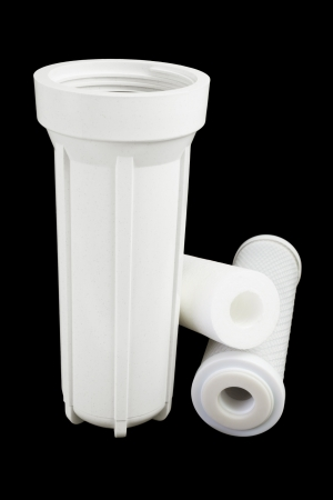 Water filter housing on a black background