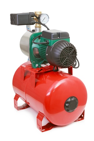 Automatic water pump with a red tank on white background Stock Photo