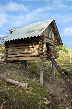 Old storage shed in the peasant economy photo