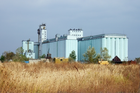 Large grain elevator rises among the steppe