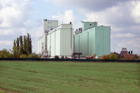 Large grain elevator rises among the fields