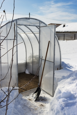 A small greenhouse in winter is empty Stock Photo