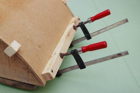 Clamps are used for gluing  workpiece of fiberboard photo