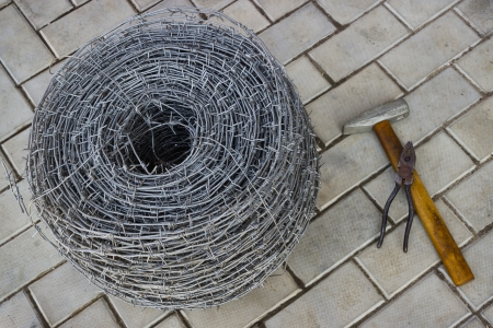 furl: Bay of barbed wire and tool on the sidewalk