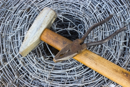 furl: Bay of barbed wire, a hammer and pliers
