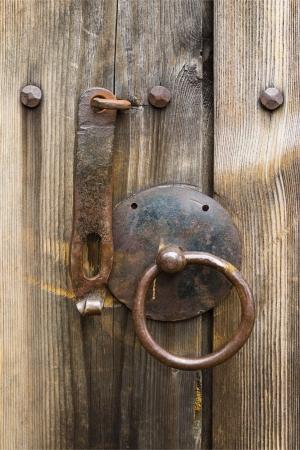 Door handle on an old wooden door photo