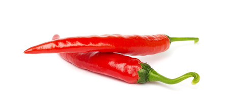 Two pods of hot pepper on a white background photo
