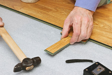 Master works on laying laminate panels, stylized wood photo