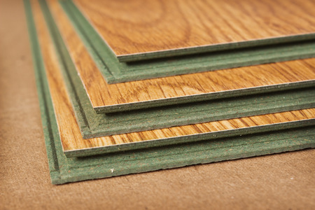 Pack of laminate panels, stylized natural wood, green base photo