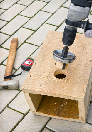 Making a birdhouse from wooden boards spring season photo