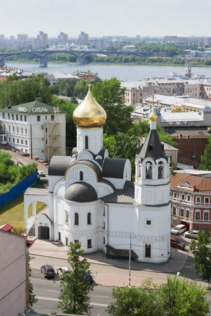 parish: RUSSIA, NIZHNY NOVGOROD - AUG 06, 2014: View of the Church of Our Lady of Kazan to the Kremlin wall. This church was destroyed during the Soviet era and the newly restored