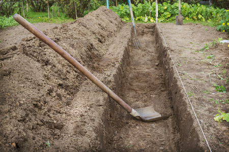 Dug a trench in the garden to make a deep bed of