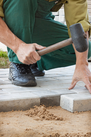Creating a pavement of stone blocks. Handmade