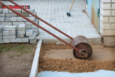 compaction: Roller compaction of soil at the construction site