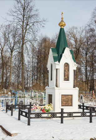 Little white chapel near the village cemetery, Russia photo