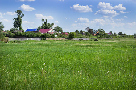 outskirts: Green meadow on the outskirts of the village