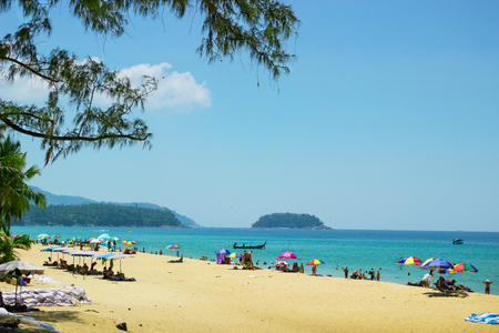 despite: PHUKET, THAILAND - FEB 26: People relax on the sandy beach in February 2015 in Phuket. Despite the holiday season, there is still not very crowded places in Phuket Editorial