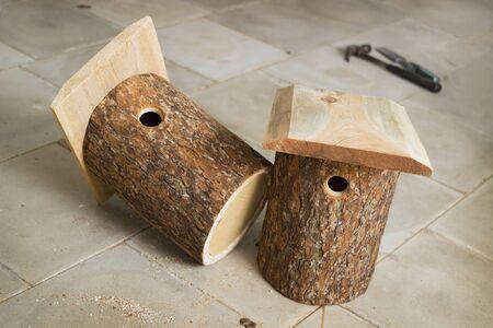 alder: Two already made birdhouse from alder logs
