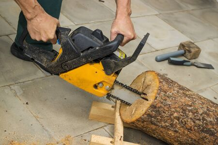 Making a birdhouse from alder logs with chainsaw photo