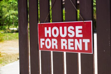 property: Announcement for rent house hanging on the fence
