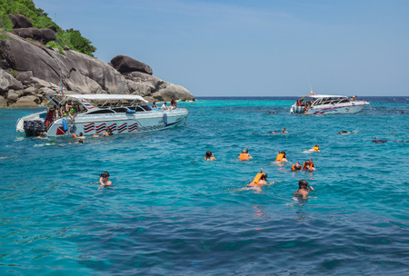 similan: Similan Islands, Thailand Feb 27 , 2015: Travelers are swimming and snorkeling in Andaman sea. Warm and Clear Ocean at Similan island on February 27, 2015