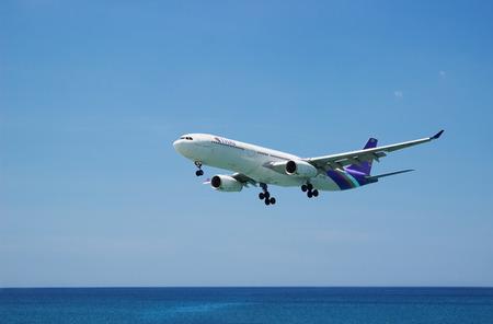 PHUKET, THAILAND - MAR 02 2015: HS-TEO Airbus A330-300 of Thai Airway. Landing in Phuket International Airport  in Thailand, flies from the ocean