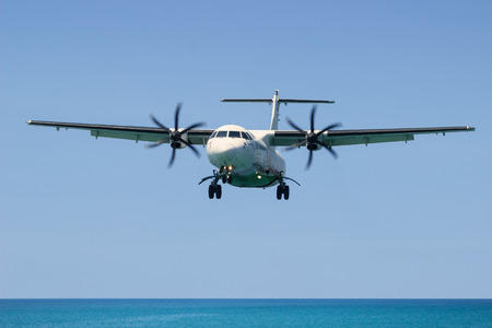 msn: PHUKET, THAILAND, MAR 02 2015: Turboprop aircraft ATR 72-212A (500) - MSN 833 - HS-PGD Airline Bangkok Airways. Landing in Phuket International Airport in Thailand, flies from the ocean