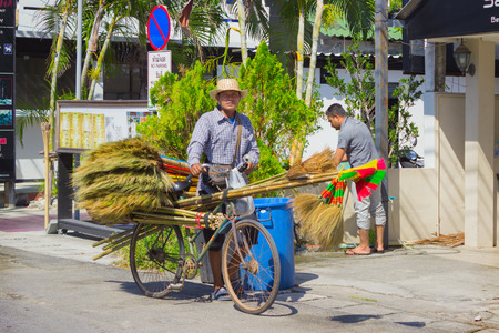 thriving: PHUKET, THAILAND - CIRCA MAR 2015: Sellers of brooms in a Thai village. Businesses small , which employed many Thai people, is thriving in Thailand