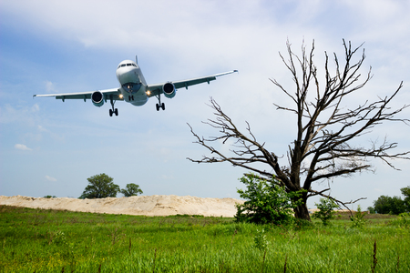 aircraft landing: Aircraft landing gear, ready for planting, approaching for airfield Stock Photo
