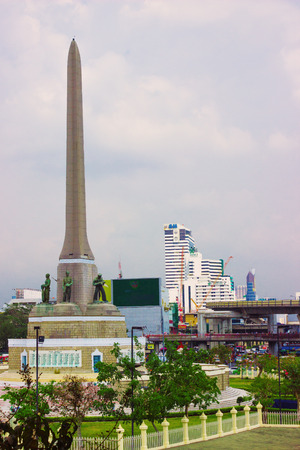 familiar: BANGKOK, THAILAND - FEB 20, 2015: Victory Monument - big military monument in Bangkok, Thailand. Monument is one of the most familiar landmarks of Bangkok Editorial