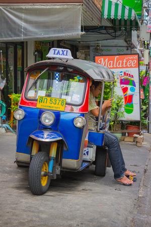mototaxi: BANGKOK, THAILAND - FEB 20, 2015: Tuktuk in downtown Bangkok, traditional moto-taxi. Tuktuk is popular among tourists Editorial