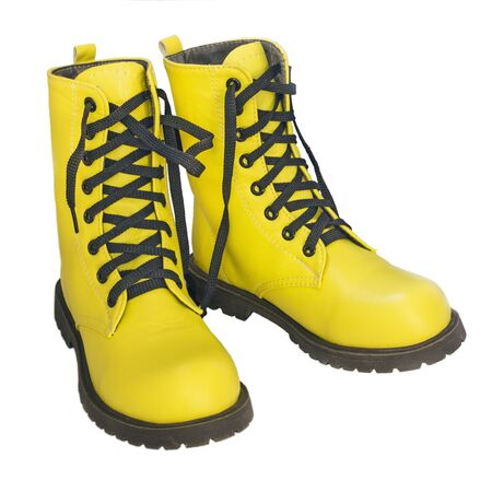 leathern: Yellow high shoes with black laces on a white background