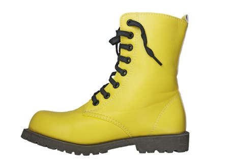 leathern: High yellow boot with black laces on a white background