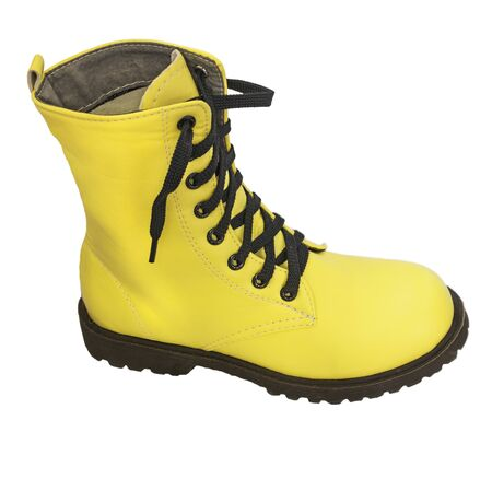 leathern: One high yellow boots with black laces on a white background
